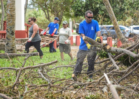 Boy Scout Troop 23/Sea Scout leader, Matt Lalumandier, uses a chain saw to cut fallen tree branches covering sidewalk paths at the Nimitz Beach Park in Agat on Saturday, Sept. 15, 2018. Leaders, members and other volunteers with the Sea Scouts and Boy Scouts of America Chamorro District conducted a cleanup at the park to collect debris and make the area safer for use by the community, District Executive Sandra Reyes Seau said.