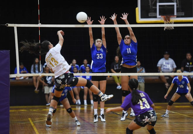 In this Sept. 15 file photo, George Washington's Bonita Castro takes on the Notre Dame defense during an IIAAG Girls' High School Girls Volleyball game at the GW gym.