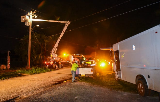 Guam Power Authority lineman works in the basket of a bucket truck repair an electrical transformer and transmission lines in order to restore power as other employees stand by for support at the Bordallo Subdivision in Yigo on Friday, Sept. 14, 2018.