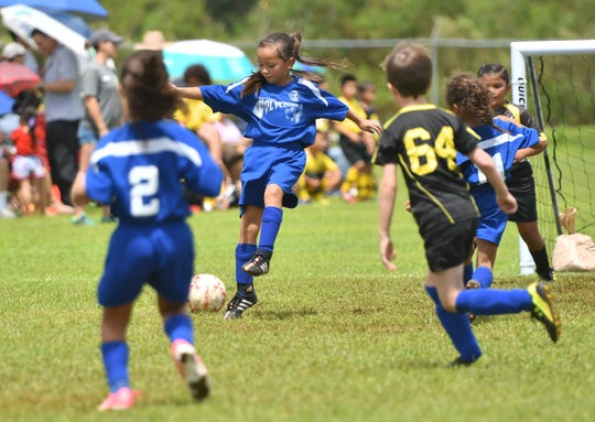 players of the Guam Shipyard Wolverines and Matson Southern Heat go toe-to-toe during their under-8 division matchup in the Robbie Webber Soccer League at the Guam Football Association National Training Center in Dededo on Saturday, Sept. 15, 2018.
