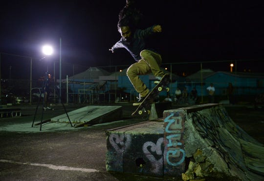 Kalani Robb does a backside blunt slide on a ledge at the Tamuning Skatepark on Wednesday, Sept. 12.