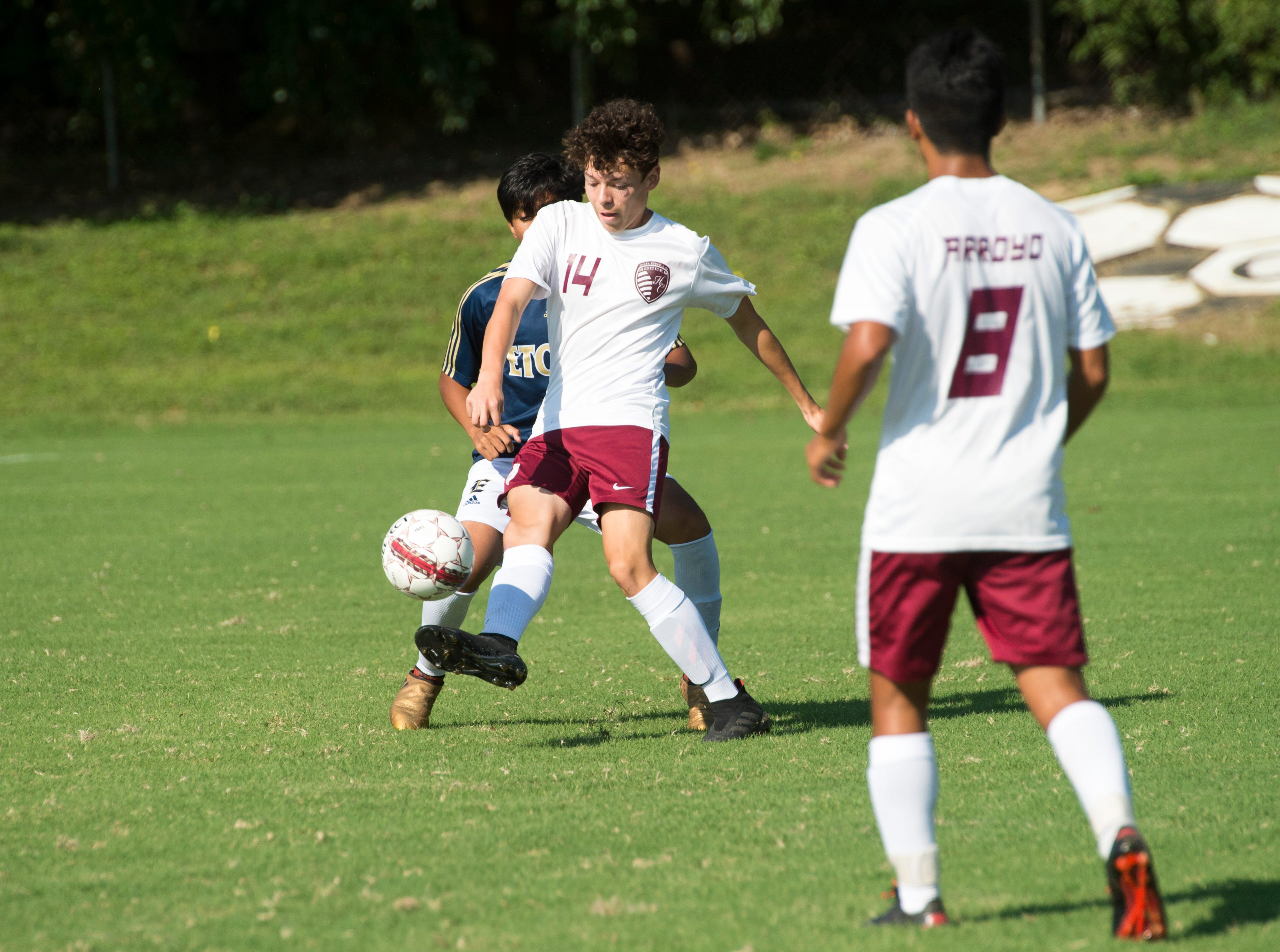 Henderson County's Jordan Toribio (14) kicks the ball downfield during the first half against the Elizabethtown Panthers at Colonel Field in Henderson, Ky., Saturday, Sept. 15, 2018.