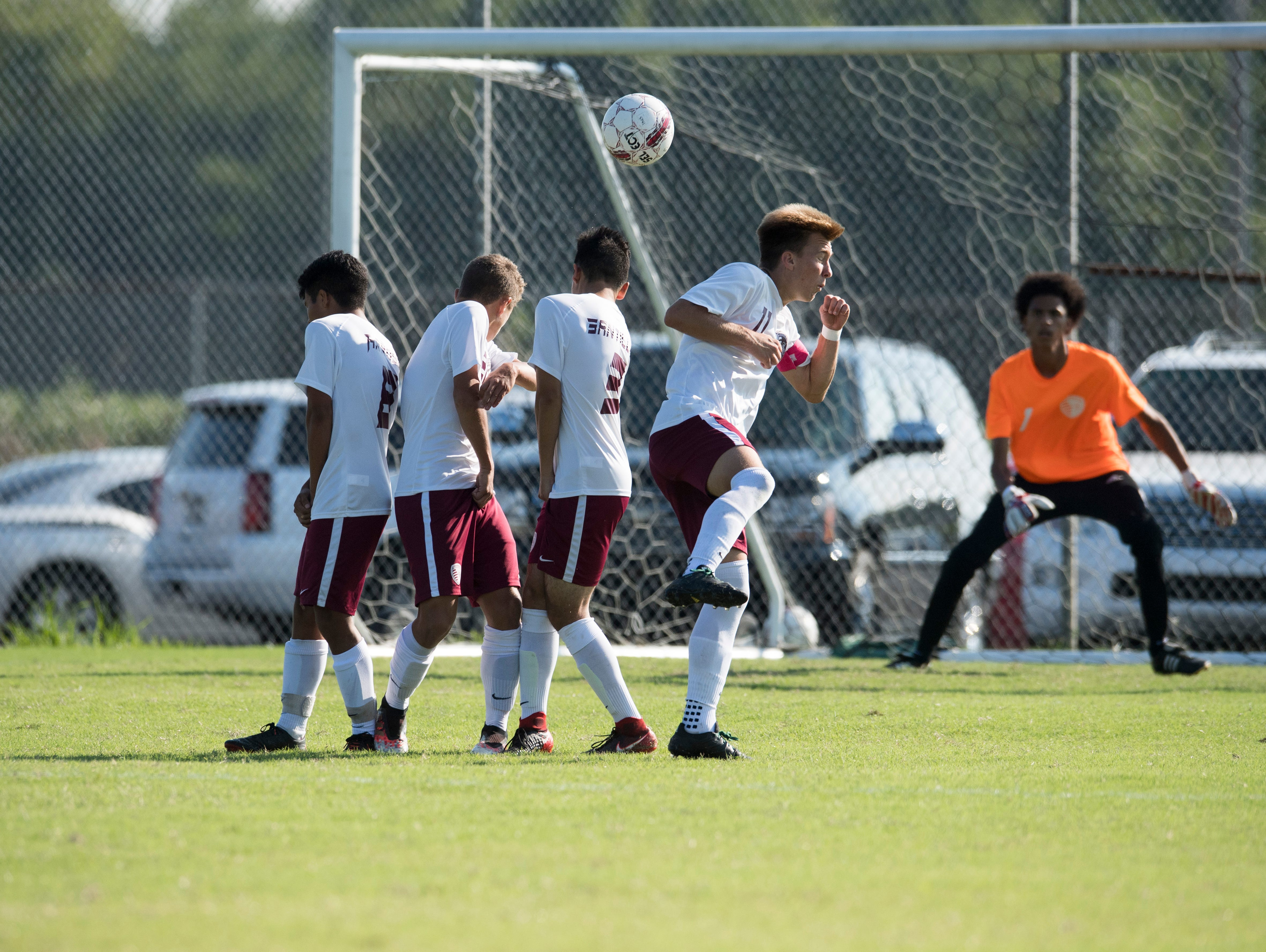 A free kick skims past the Henderson County Colonels  wall during the first half against the Elizabethtown Panthers at Colonel Field in Henderson, Ky., Saturday, Sept. 15, 2018.