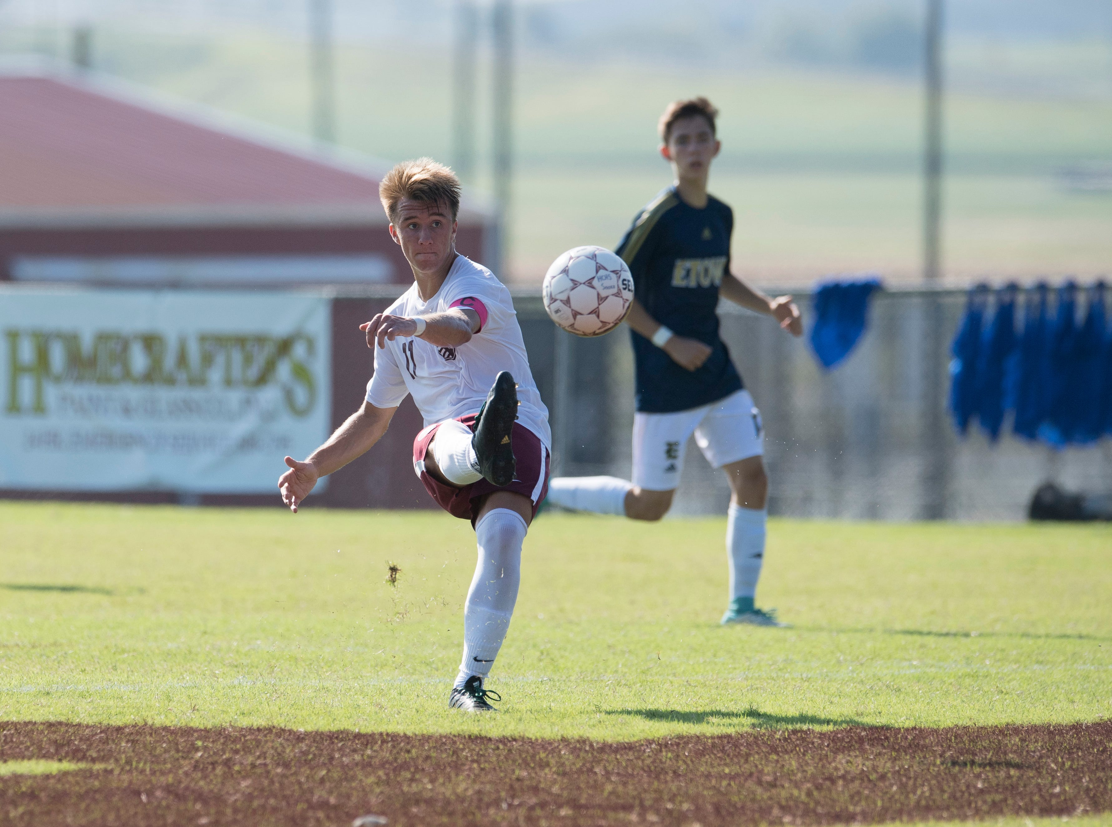 Henderson County's Max Wawrin (11) kicks the ball downfield during the first half against the Elizabethtown Panthers at Colonel Field in Henderson, Ky., Saturday, Sept. 15, 2018.