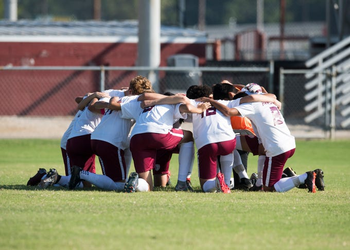 The Henderson County Colonels huddle on the field before taking on the Elizabethtown Panthers at Colonel Field in Henderson, Ky., Saturday, Sept. 15, 2018.