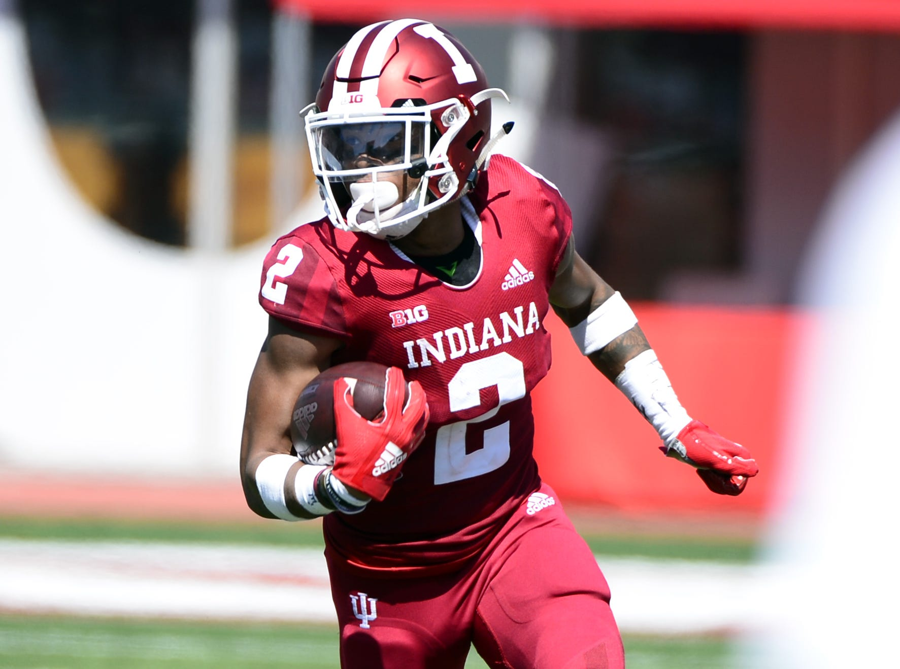 Indiana Hoosiers athlete Reese Taylor (2) runs the ball during the game against Ball State at Memorial Stadium in Bloomington, Ind., on Saturday, Sept. 15, 2018.
