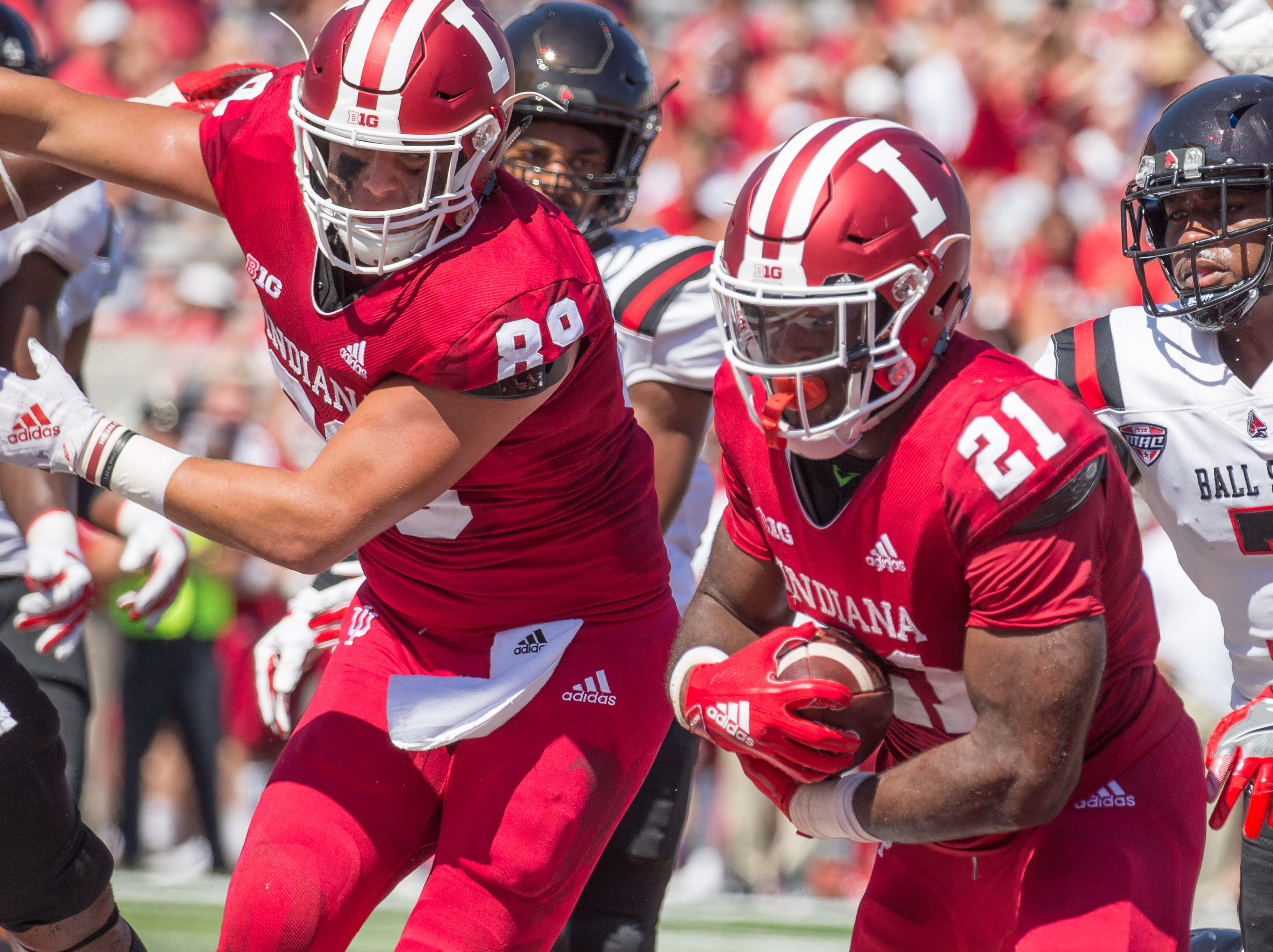 Sep 15, 2018; Bloomington, IN, USA; Indiana Hoosiers running back Stevie Scott (21) runs for a touchdown while Ball State Cardinals safety Bryce Cosby (5) and cornerback Marc Walton (7) defend in the second quarter at Memorial Stadium .