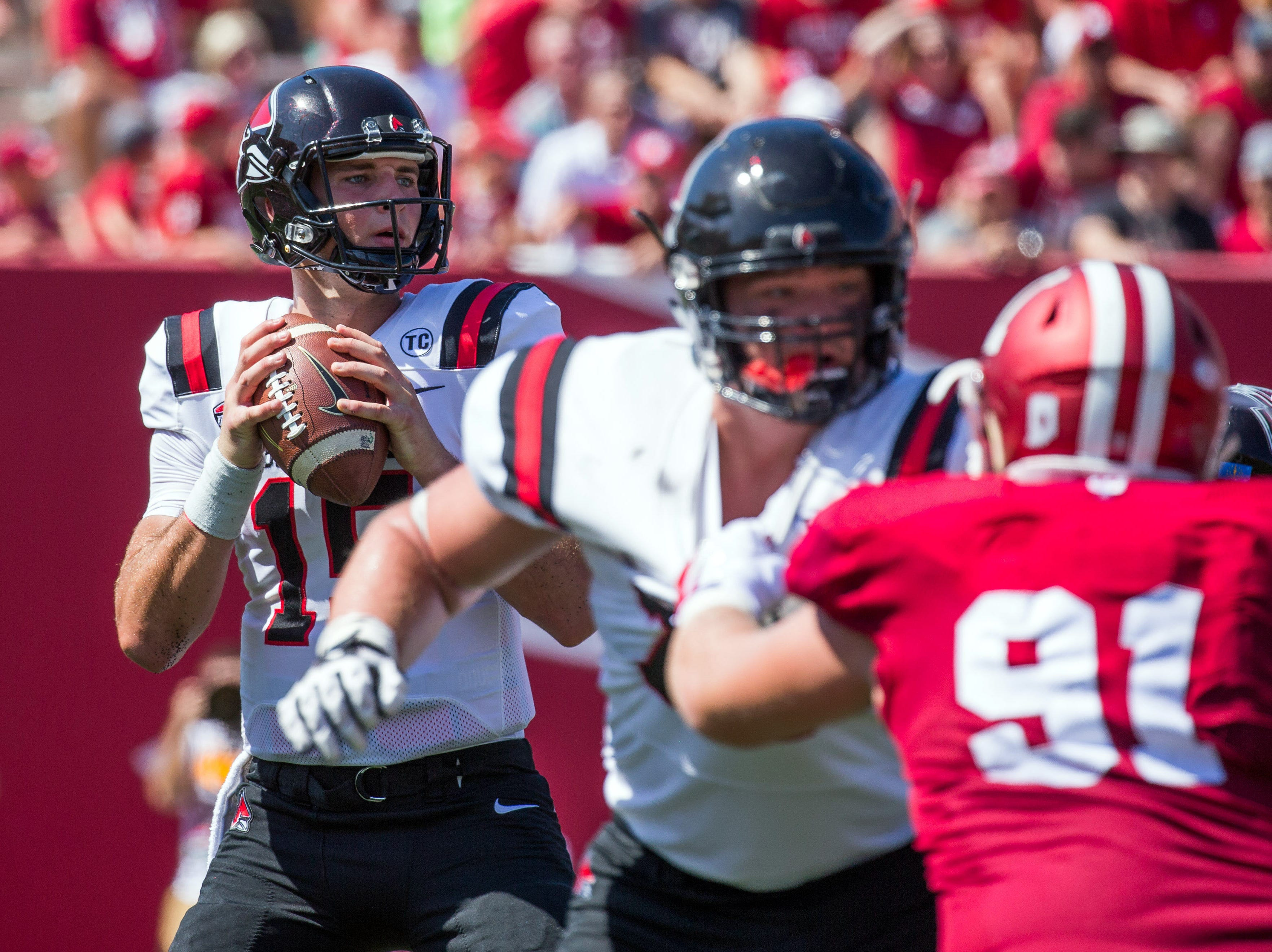 Ball State Cardinals quarterback Riley Neal (15) drops back to pass the ball in the second quarter against the Indiana Hoosiers at Memorial Stadium .