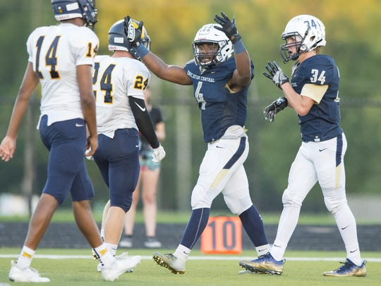 Decatur Central High School senior Will Gibson (4) reacts after scoring during the first half of action. Decatur Central High School hosted Mooresville High School in IHSAA varsity football action, Friday, Sept. 14, 2018.