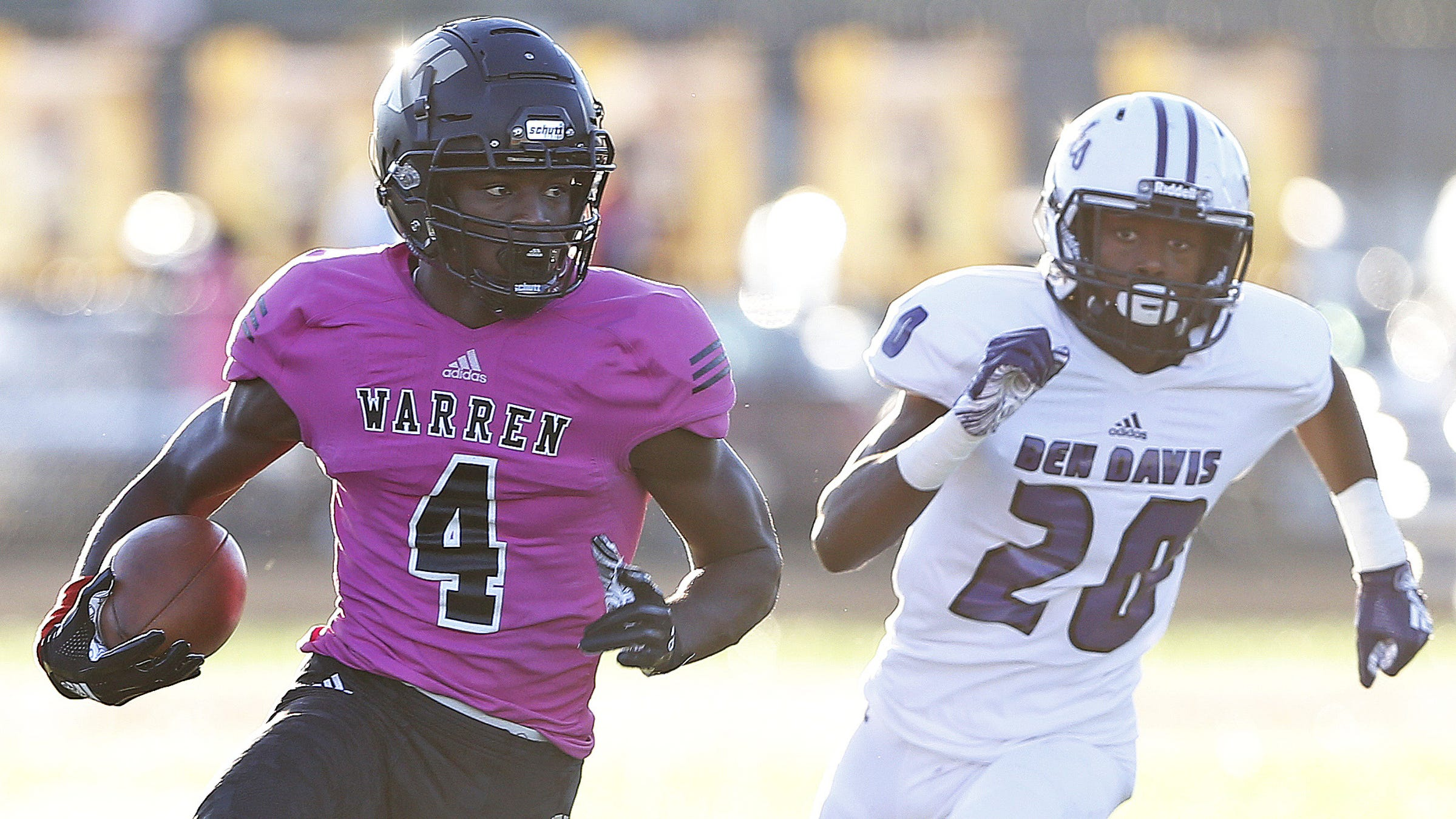 Warren Central's David Bell runs the ball for...