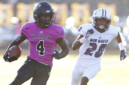 Warren Central's David Bell runs the ball for first down in the first half of the game against Ben Davis' Kenny Fairer at Warren Central High School in Indianapolis, Ind., Friday, Sept. 7, 2018. Warren Central defeated Ben Davis 70-27.