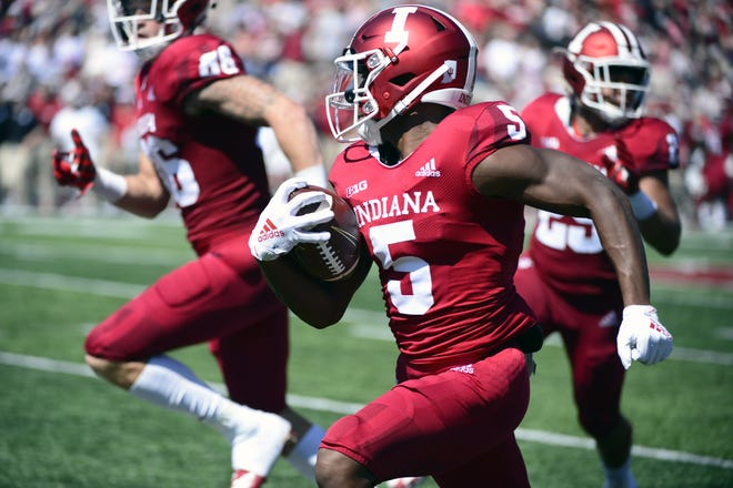 Indiana Hoosiers wide receiver J-Shun Harris II (5) returns a punt for a touchdown during the game against Ball State at Memorial Stadium in Bloomington, Ind., on Saturday, Sept. 15, 2018.