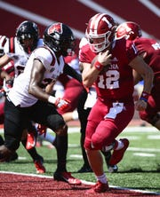 Hoosiers QB Peyton Ramsey (12) runs for a touchdown against Ball State on Saturday.