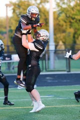Zionsville's Jordan Hull (1) and Zionsville's Noah Richardson (69) celebrate a touch down during the first half of Zionsville vs. Noblesville High School varsity football held at Zionsville High School, September 14, 2018.
