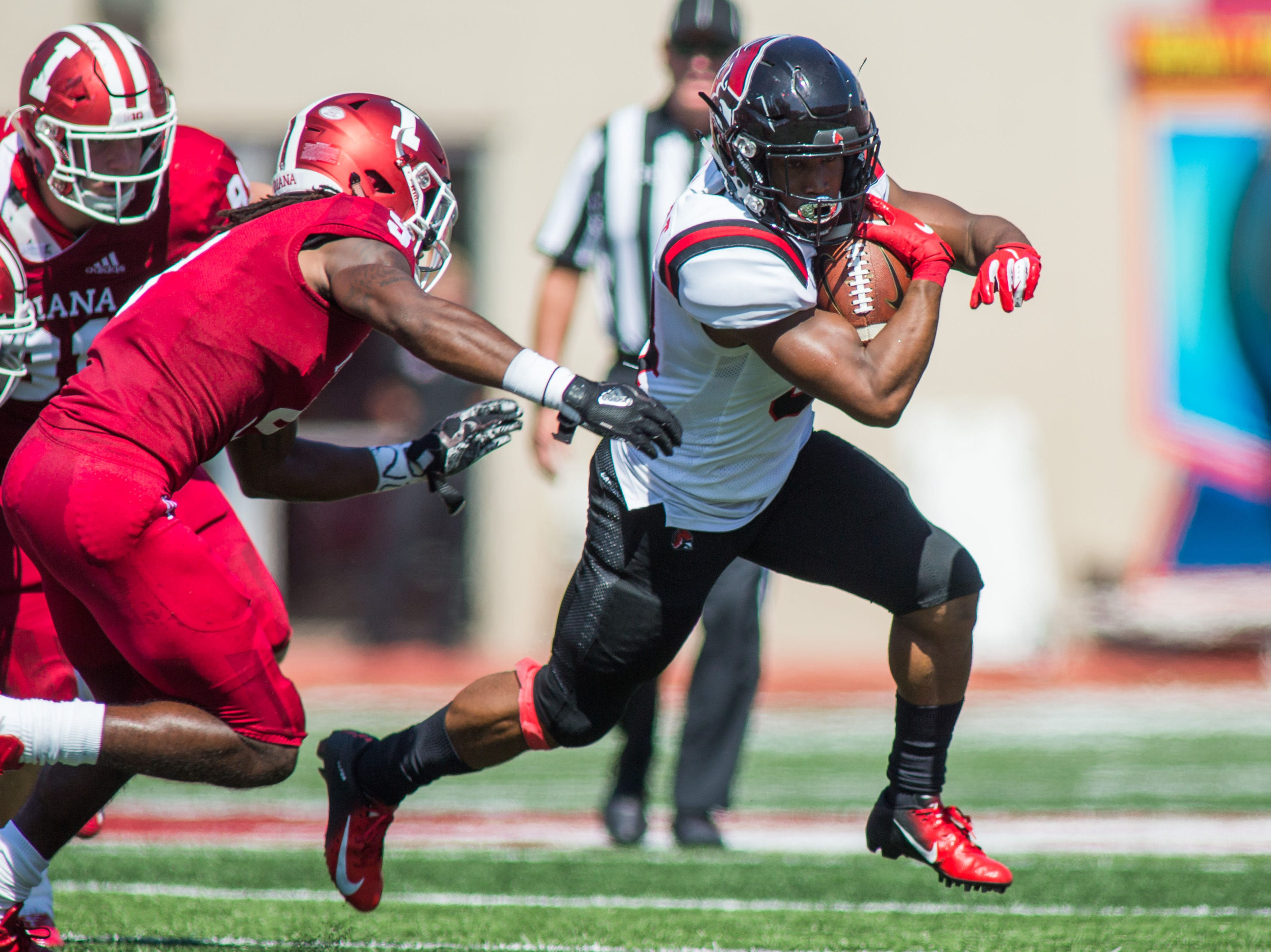 Ball State Cardinals running back James Gilbert (34) runs the ball in the first quarter against the Indiana Hoosiers at Memorial Stadium .