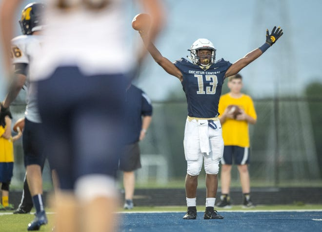 Decatur Central High School junior Kenneth Tracy (13) reacts after scoring a touchdown during the first half of action. Decatur Central High School hosted Mooresville High School in IHSAA varsity football action, Friday, Sept. 14, 2018.