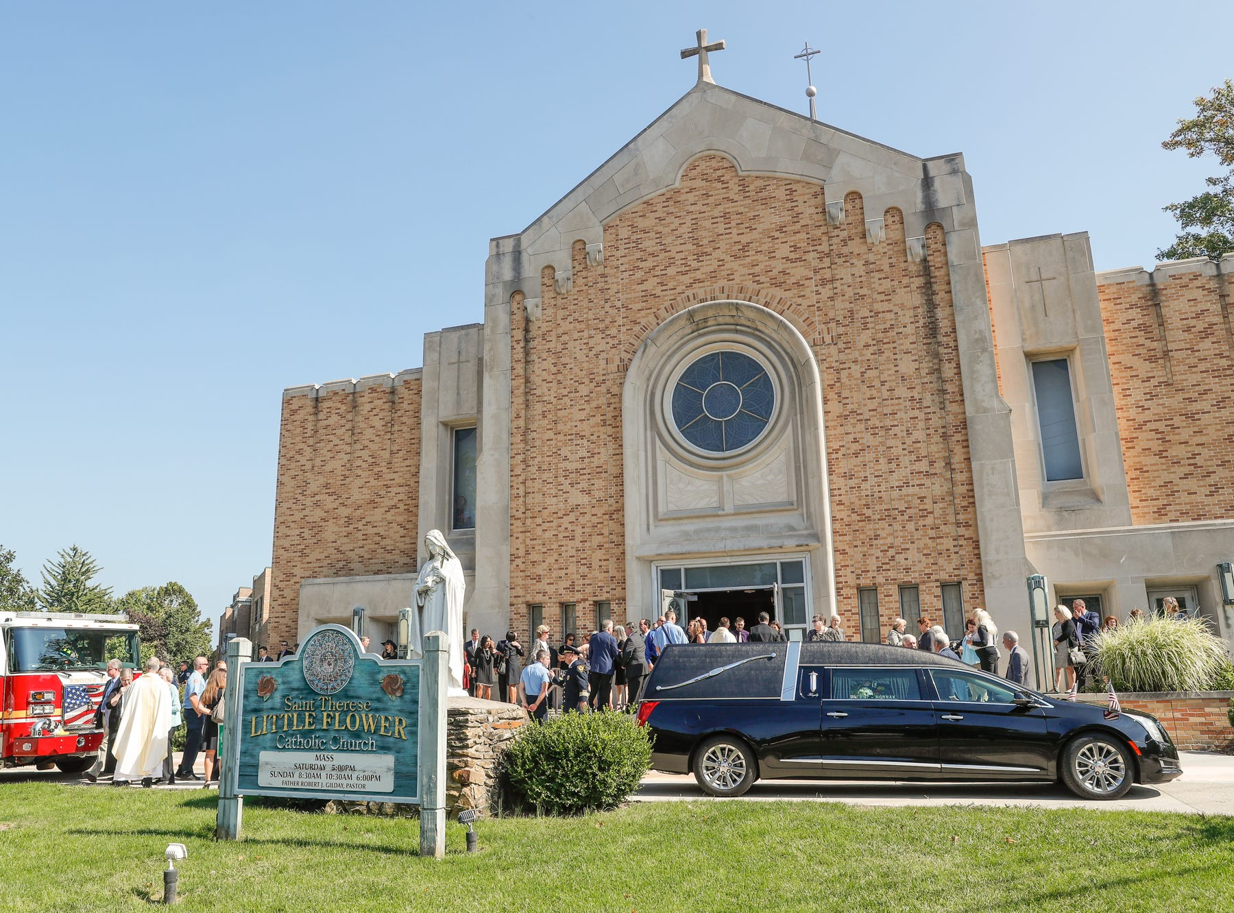 The funeral procession prepares to depart after the Mass of Christian Burial for longtime public servant Mary Moriarty Adams, held at Little Flower Catholic Church in Indianapolis on Saturday, Sept. 15, 2018.