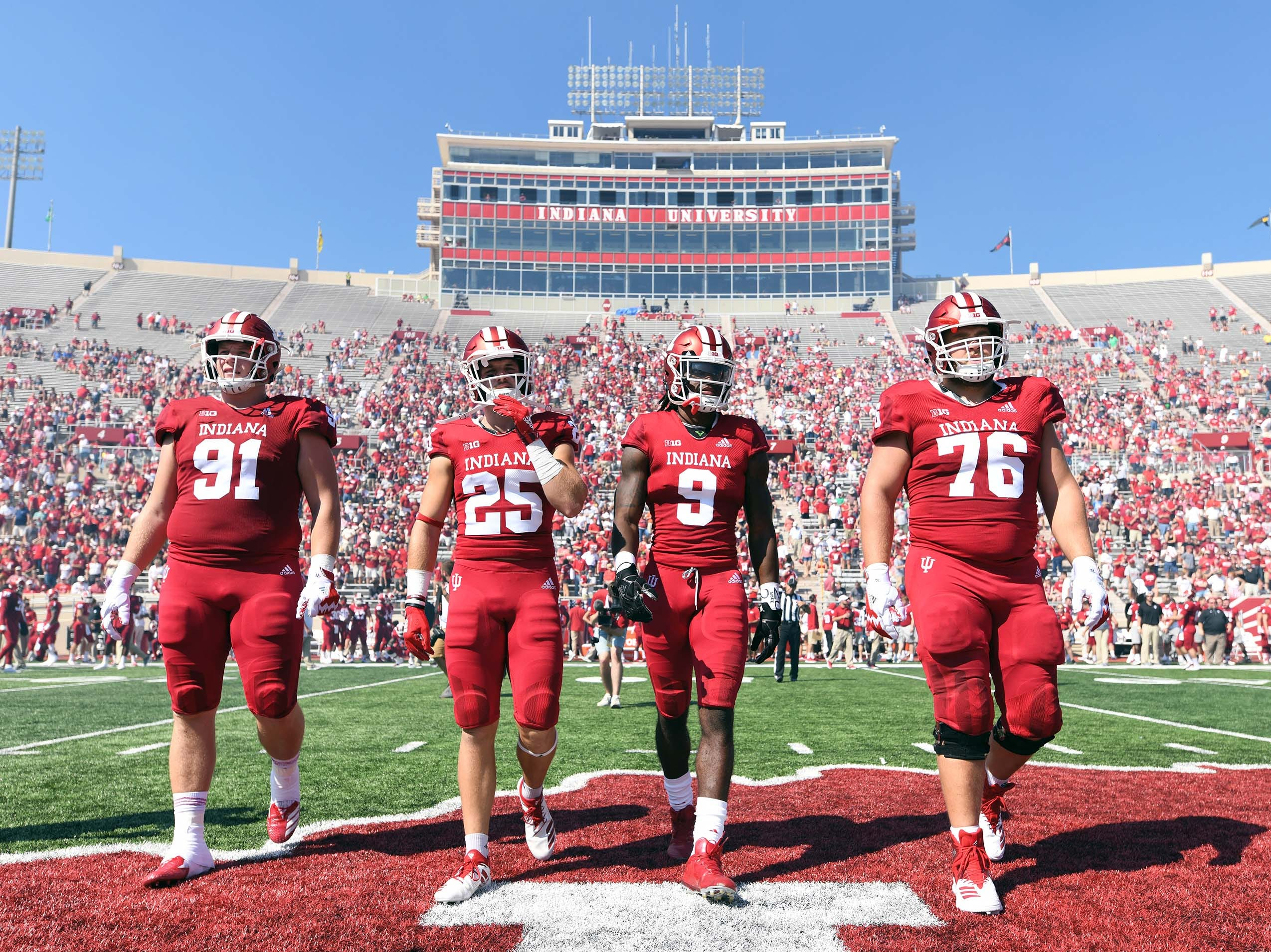 The Indiana Hoosiers captains walk to the coin toss prior to the start of the game against Ball State at Memorial Stadium in Bloomington, Ind., on Saturday, Sept. 15, 2018.