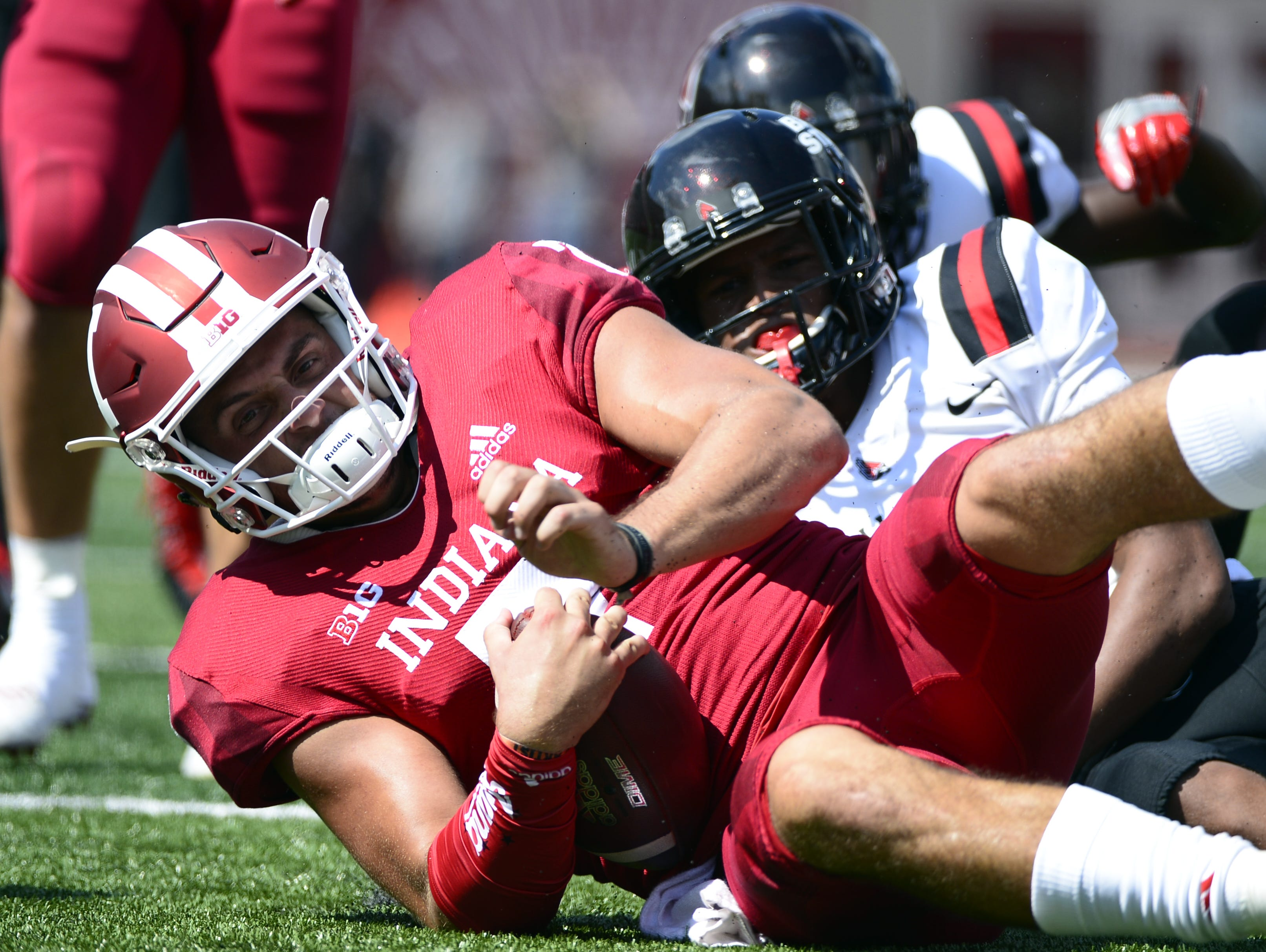 Indiana Hoosiers quarterback Mike Fiacable (7) is tackled during the game against Ball State at Memorial Stadium in Bloomington, Ind., on Saturday, Sept. 15, 2018.