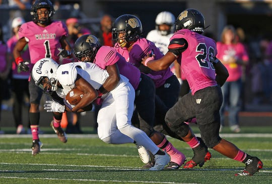 Ben Davis' Daylan Carnell is taken down by Warren Central's defense in the first half of the game at Warren Central High School in Indianapolis, Ind., Friday, Sept. 7, 2018. Warren Central defeated Ben Davis 70-27.