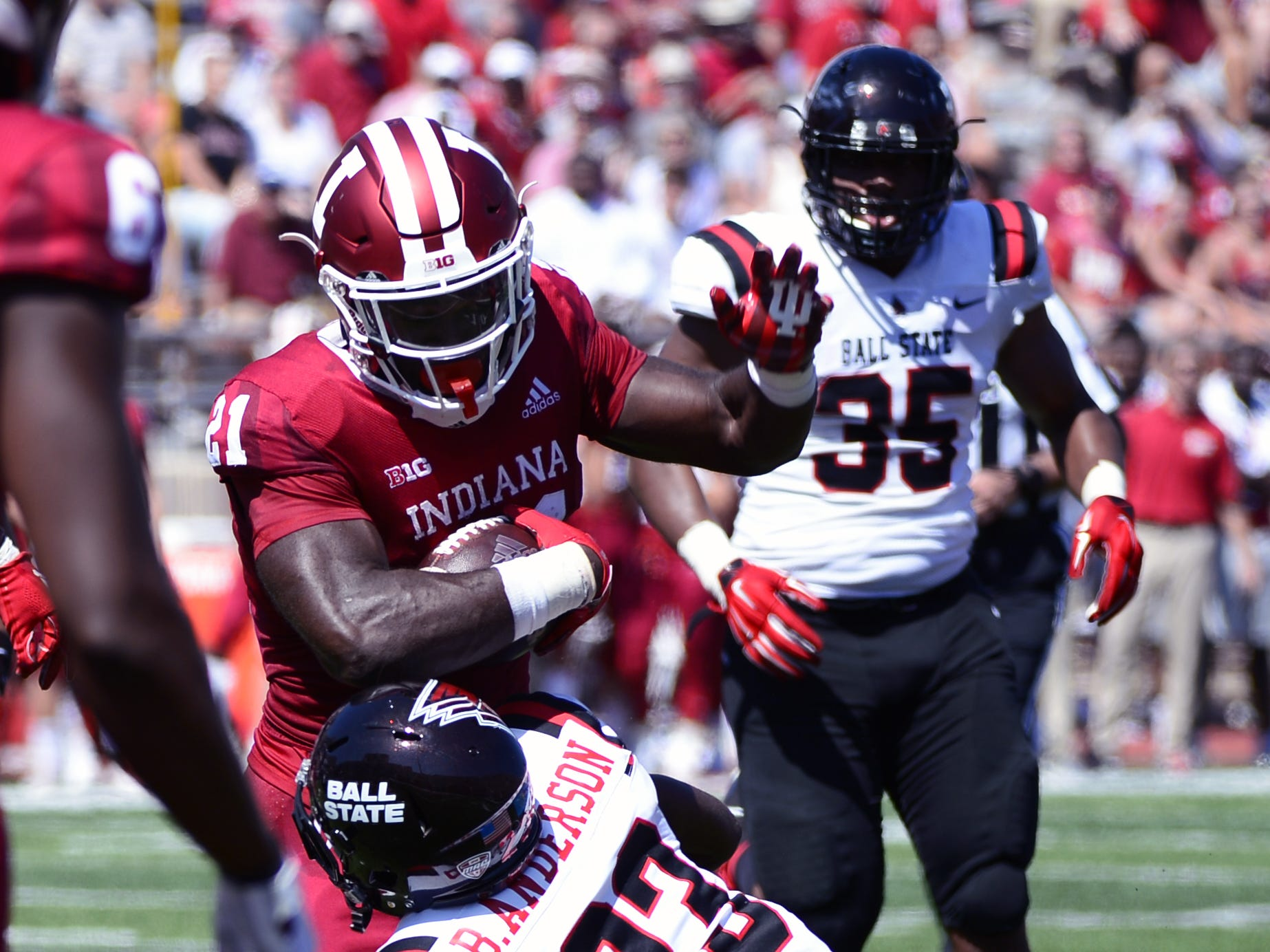Indiana Hoosiers running back Stevie Scott (21) is tackled by Ball State safety Brett Anderson II (23) during the game against Ball State at Memorial Stadium in Bloomington, Ind., on Saturday, Sept. 15, 2018.