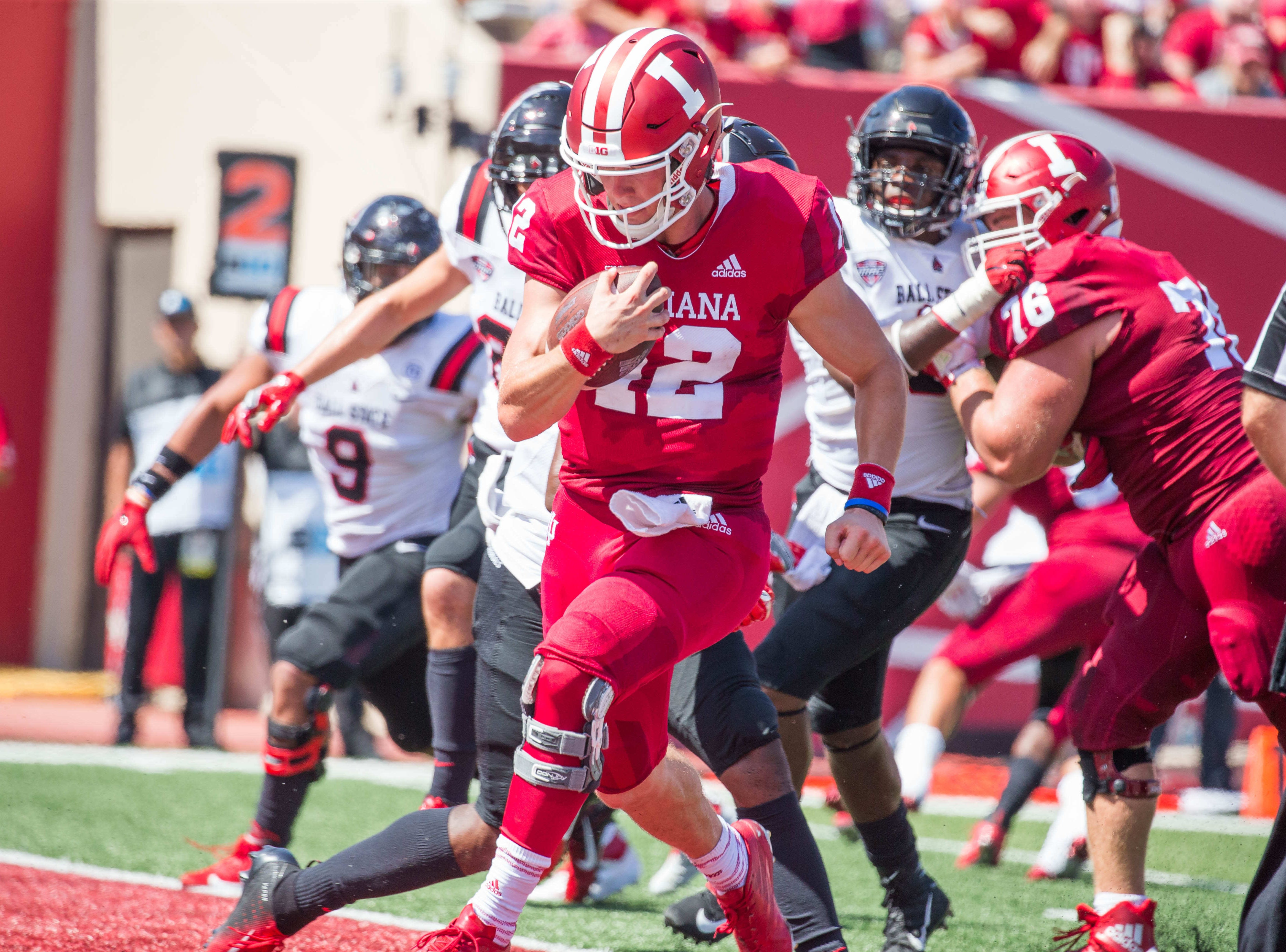 Indiana Hoosiers quarterback Peyton Ramsey (12) runs for a touchdown in the second quarter against the Ball State Cardinals at Memorial Stadium .