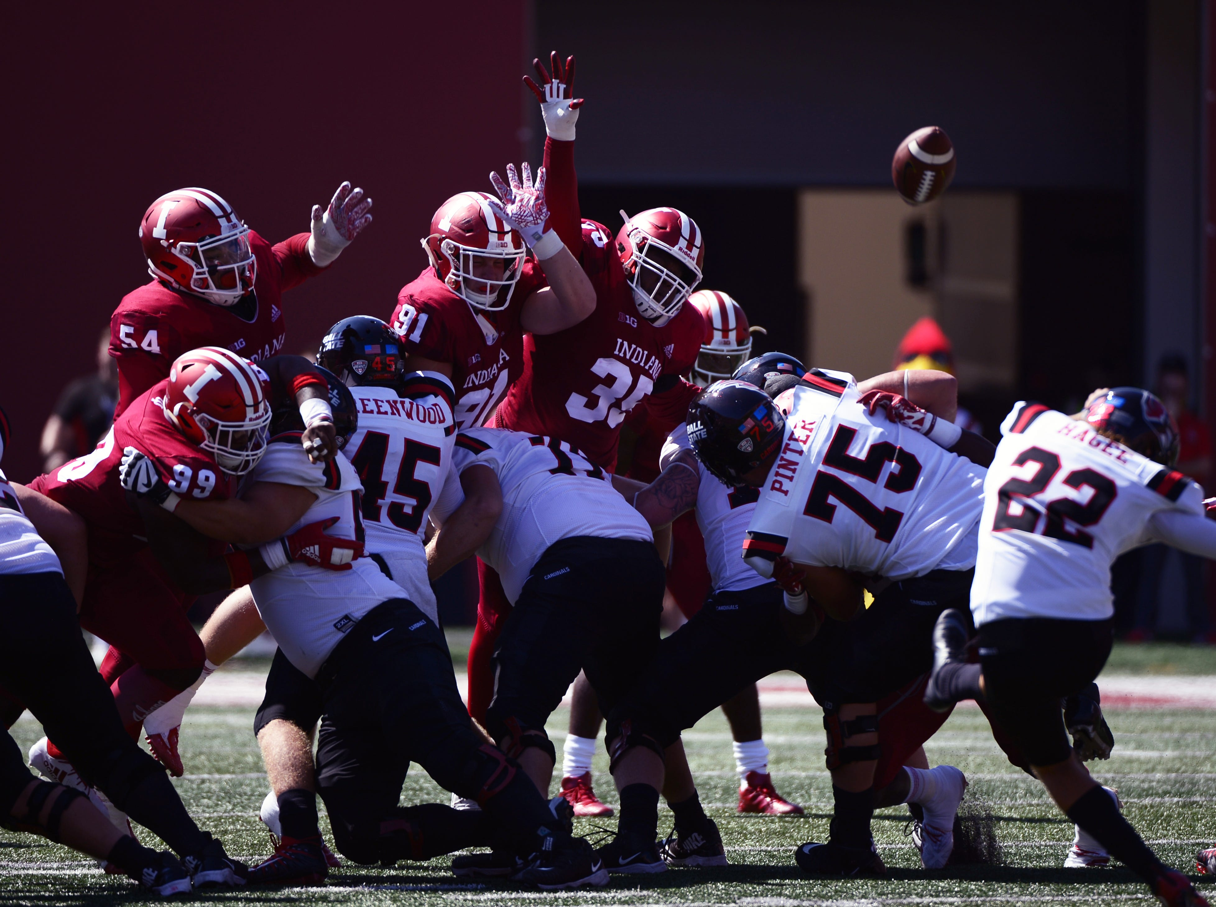 The Indiana Hoosiers defensive line tries to block a kick during the game against Ball State at Memorial Stadium in Bloomington, Ind., on Saturday, Sept. 15, 2018.