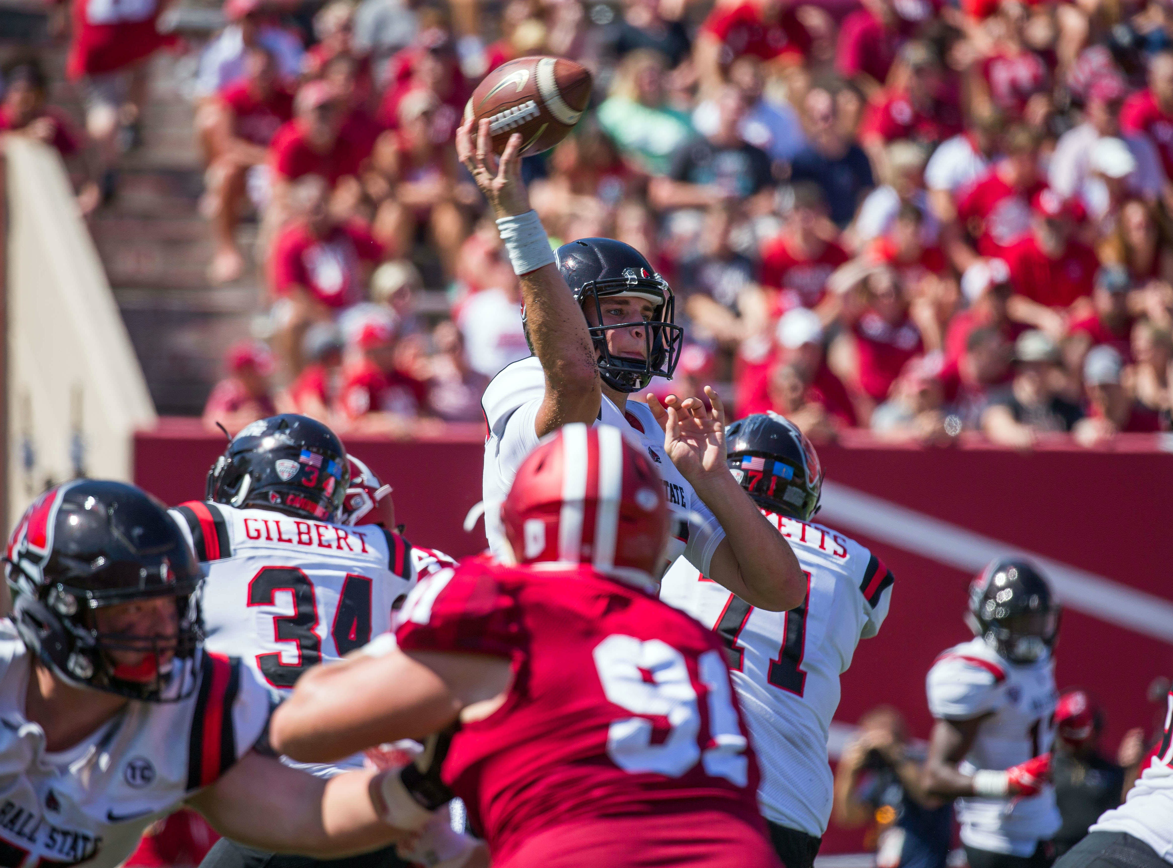 Ball State Cardinals quarterback Riley Neal (15) passes the ball in the second quarter against the Indiana Hoosiers at Memorial Stadium .