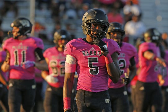 Warren Central's Montrez Stanley takes the field with his teammates in the first half of the game against Ben Davis at Warren Central High School in Indianapolis, Ind., Friday, Sept. 7, 2018. Warren Central defeated Ben Davis 70-27.