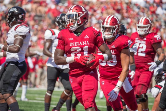 Indiana Hoosiers running back Stevie Scott (21) celebrates his touchdown in the first quarter against the Ball State Cardinals at Memorial Stadium .