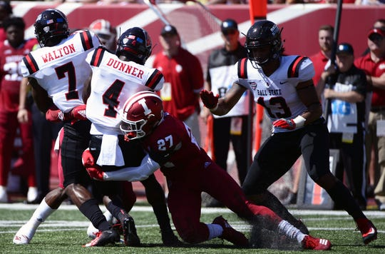 Indiana Hoosiers defensive back Devon Matthews (27) tackles Ball State running back Malik Dunner (4) during the game against Ball State at Memorial Stadium in Bloomington, Ind., on Saturday, Sept. 15, 2018.