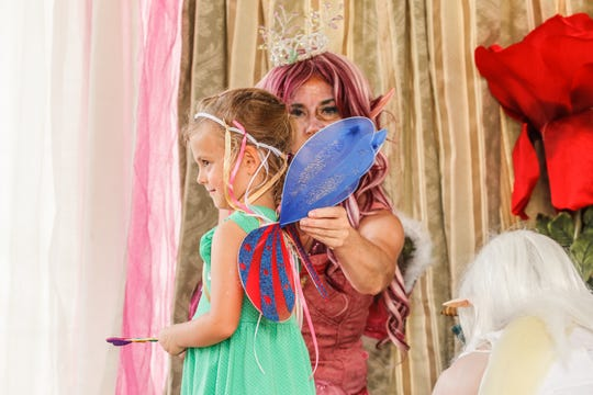 Hannah Chamberlin, left, plays with Irish fairy queens during the Indy Irish Fest at Military Park in Indianapolis on Sept. 15, 2018.