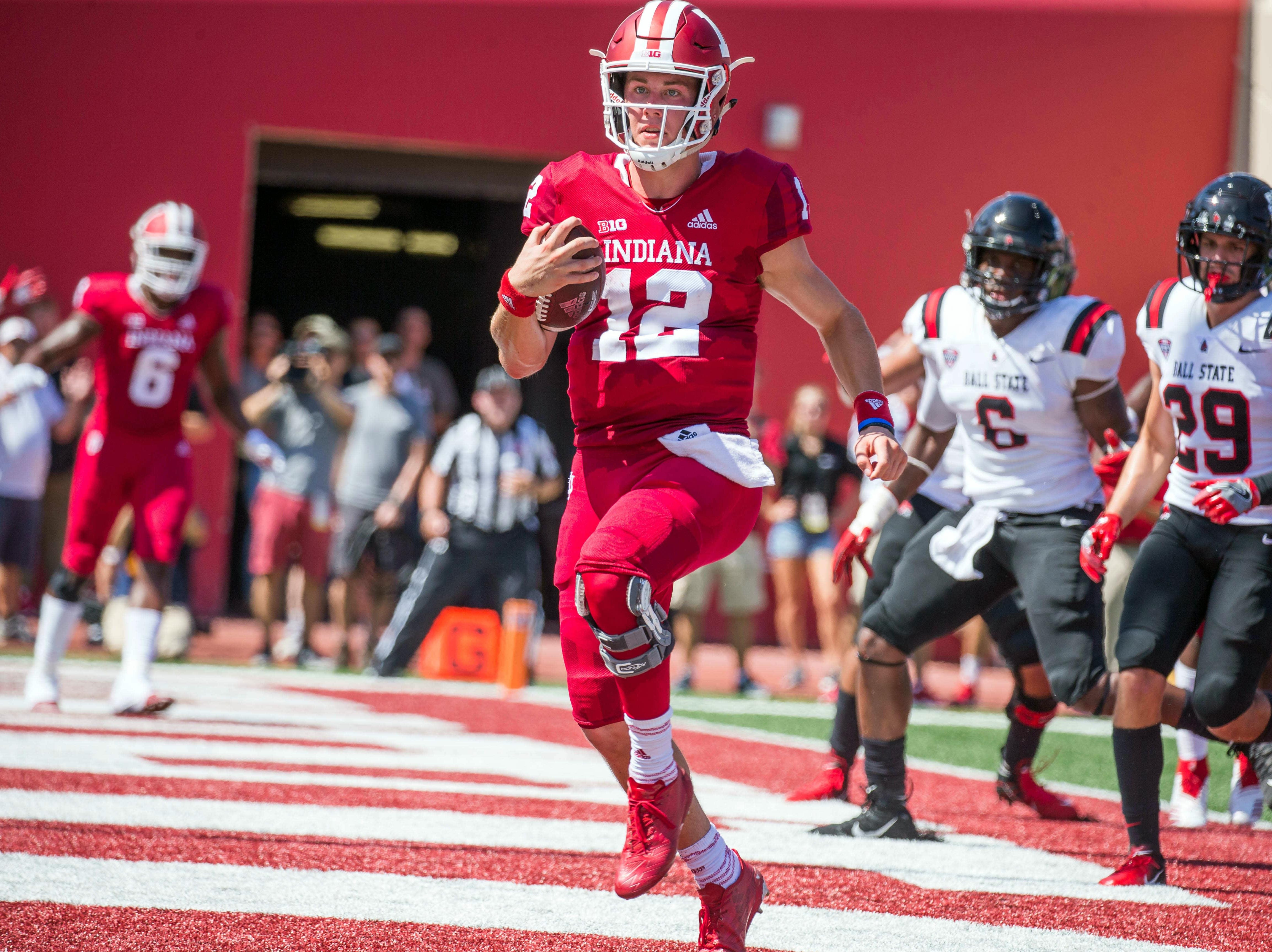 Indiana Hoosiers quarterback Peyton Ramsey (12) celebrates a touchdown in the second quarter against the Ball State Cardinals at Memorial Stadium .