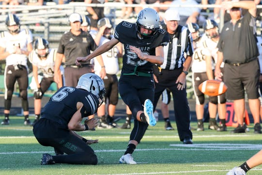 Zionsville's Chris Freeman (23) makes a field goal attempt during the first half of Zionsville vs. Noblesville High School varsity football held at Zionsville High School, September 14, 2018.