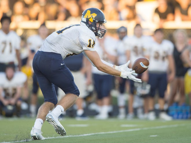Mooresville High School senior Jon Eineman (11) pulls in a huge pass reception that he turned into a touchdown during the first half of action. Decatur Central High School hosted Mooresville High School in IHSAA varsity football action, Friday, Sept. 14, 2018.