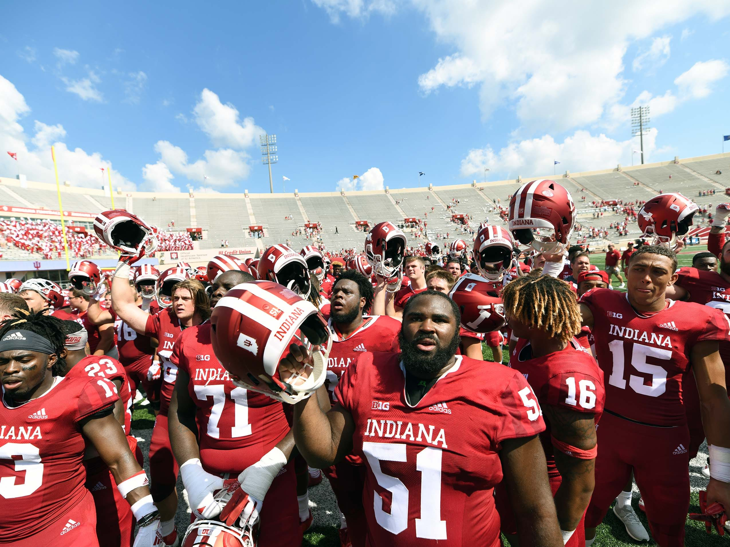 The Indiana Hoosiers celebrate after defeating Ball State at Memorial Stadium in Bloomington, Ind., on Saturday, Sept. 15, 2018.