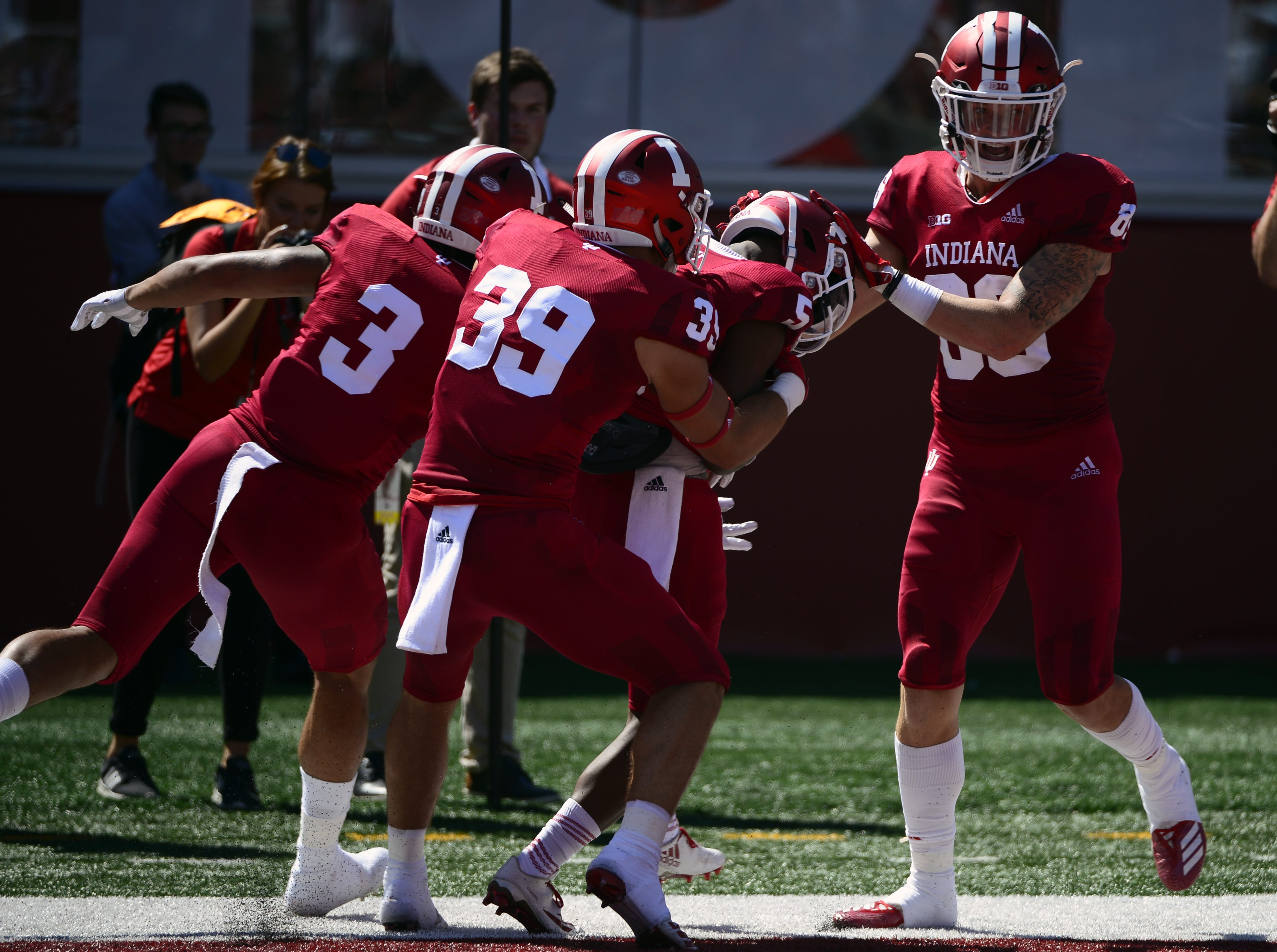 The Indiana Hoosiers celebrate after J-Shun Harris II (5) scores a touchdown during the game against Ball State at Memorial Stadium in Bloomington, Ind., on Saturday, Sept. 15, 2018.