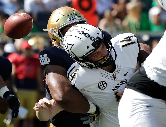 Vanderbilt quarterback Kyle Shurmur (14) is sacked by Notre Dame defensive line Jerry Tilery during the first half of an NCAA college football game in South Bend, Ind., Saturday, Sept. 15, 2018.