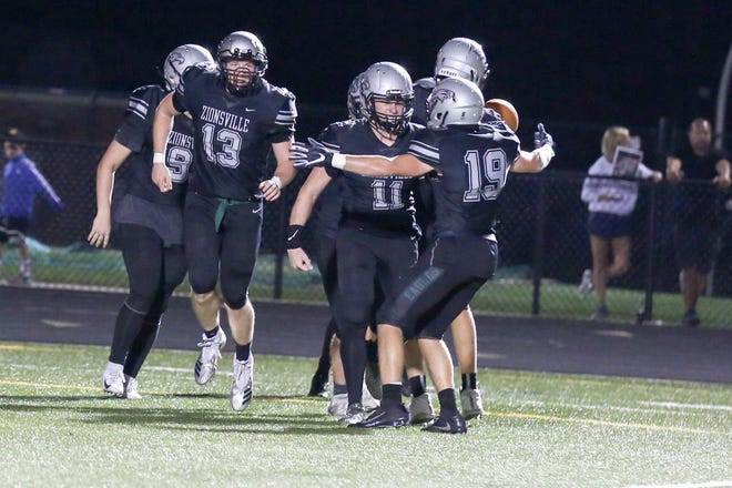 Zionsville's Deuce Thomas (11) celebrate his interception and run to the 1 yard line during the second half of Zionsville vs. Noblesville High School varsity football held at Zionsville High School, September 14, 2018.