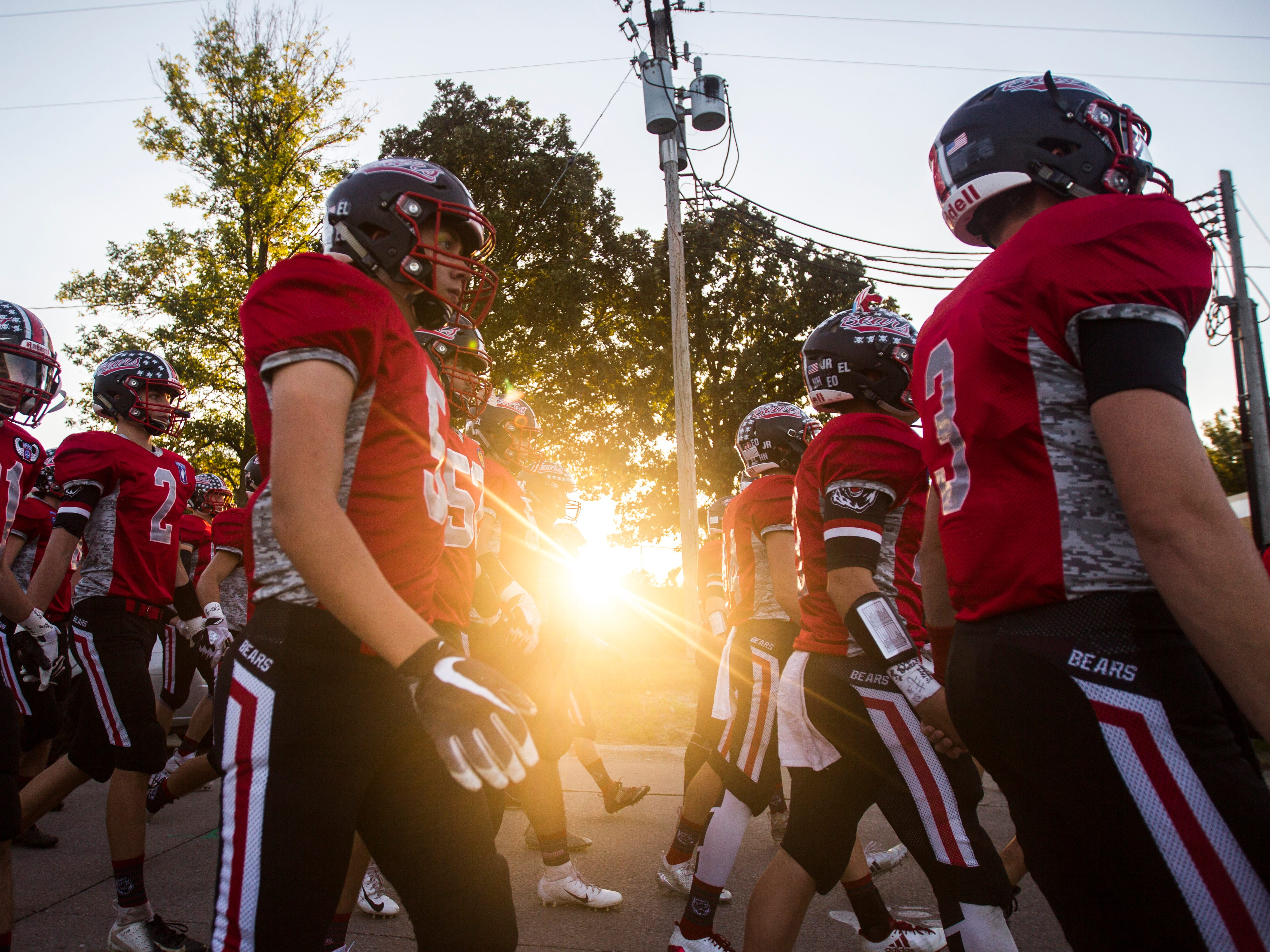 West Branch players walk towards the field before a Class 1A varsity football game on Friday, Sept. 14, 2018, at the Little Rose Bowl in West Branch.