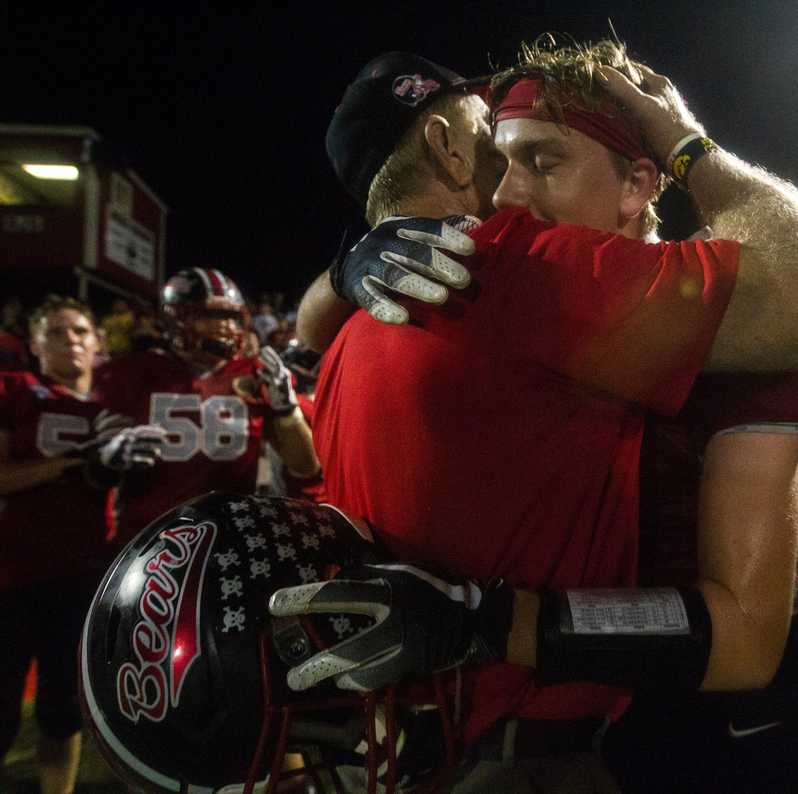 West Branch football head coach Butch Pedersen is embraced by his players after a Class 1A varsity football game on Friday, Sept. 14, 2018, at the Little Rose Bowl in West Branch. West Branch defeated Tipton, 56-13, marking Pedersen's 300th win as head coach.