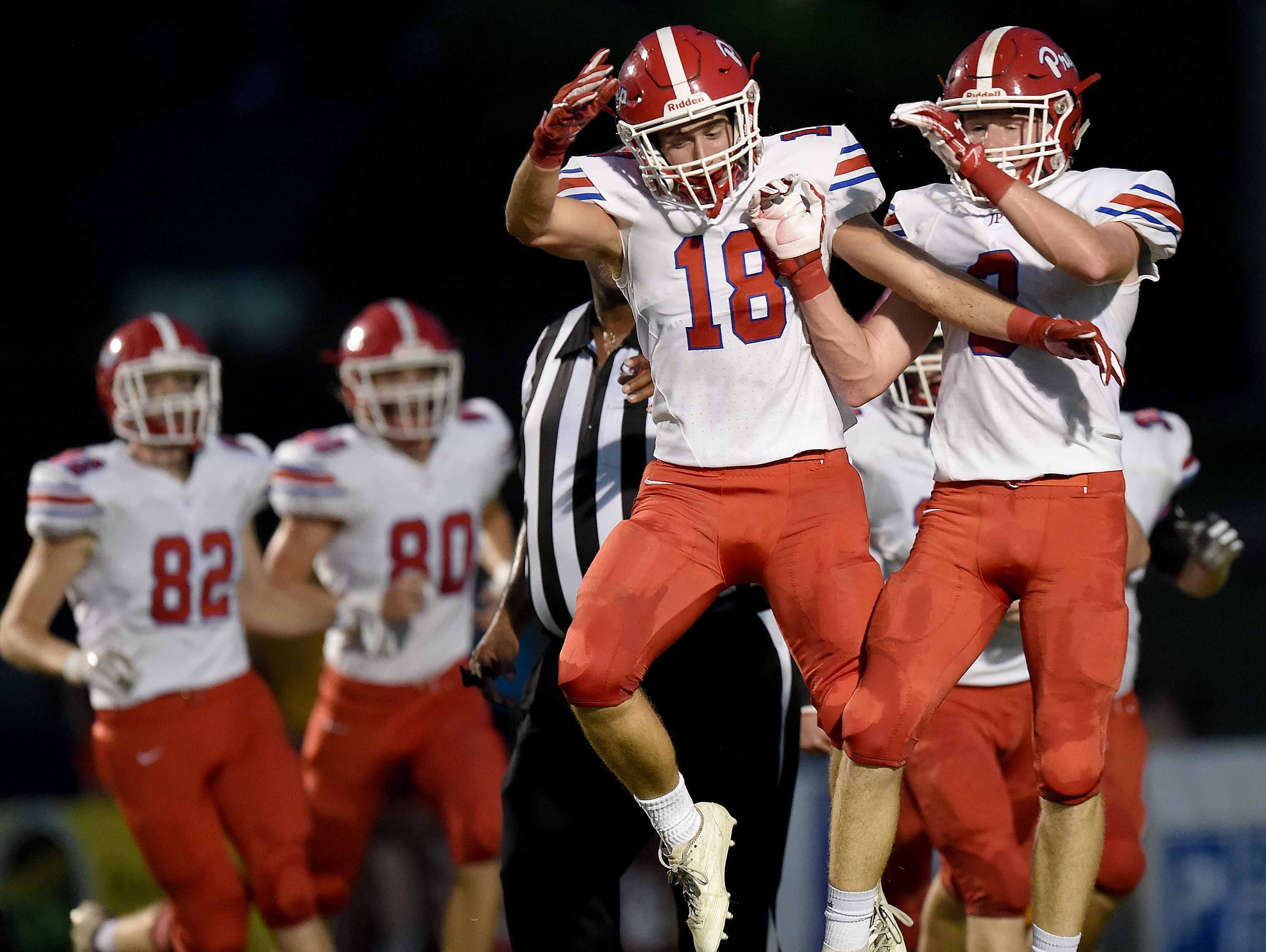Prep's Spence Graves (right) celebrates his interception return for a touchdown with Robert Griffis (18) on Friday, September 14, 2018, at St. Joseph Catholic School in Madison, Miss.