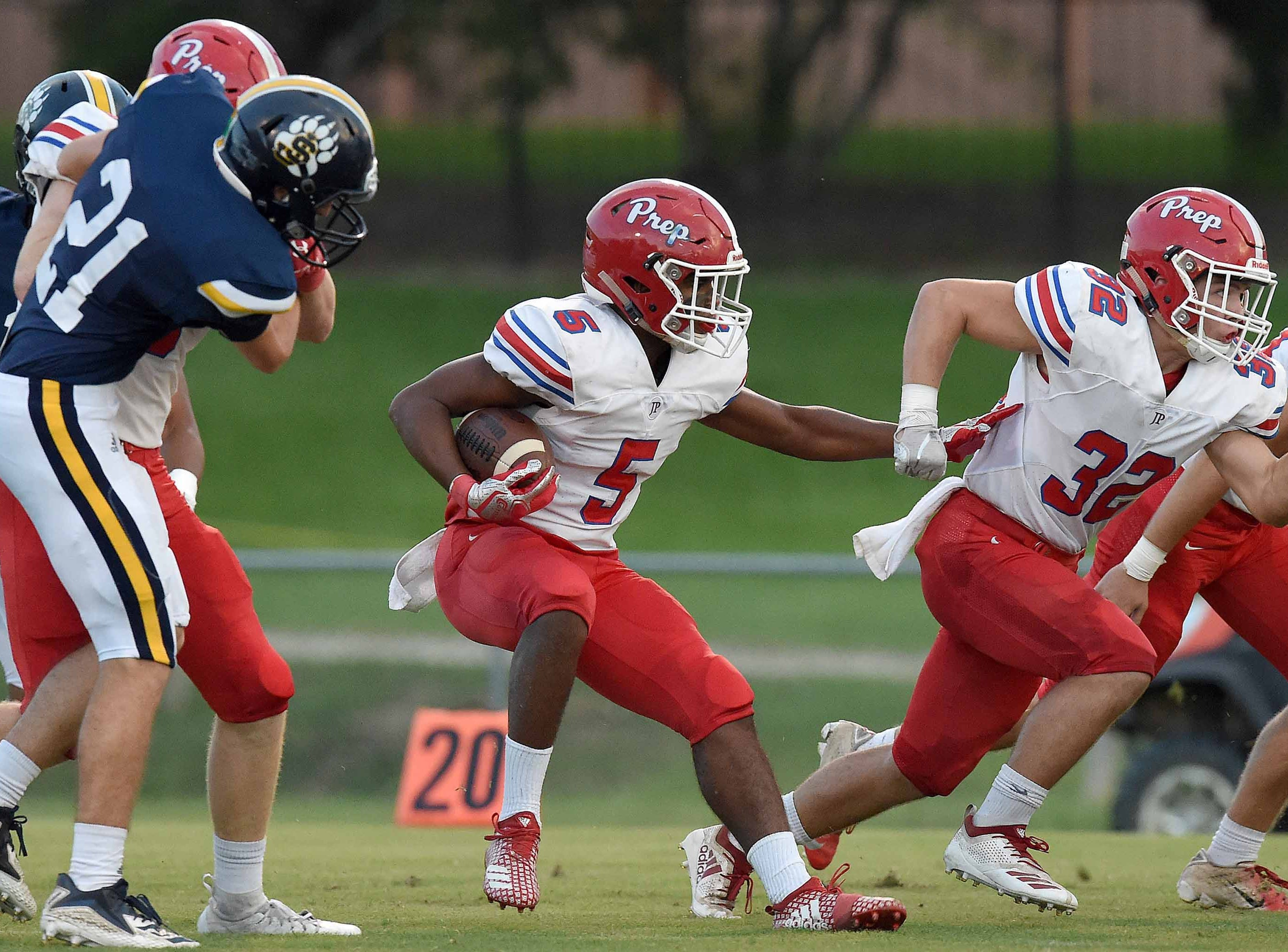 Prep's Matt Jones (5) follows Seth Cook (32) into the St. Joseph defensive line on Friday, September 14, 2018, at St. Joseph Catholic School in Madison, Miss.