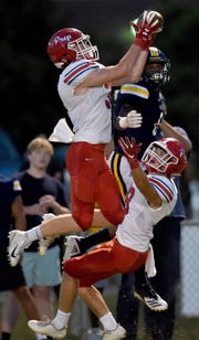Prep's Spence Graves intercepts a St. Joseph pass that he would return for a touchdown on Friday, September 14, 2018, at St. Joseph Catholic School in Madison, Miss.