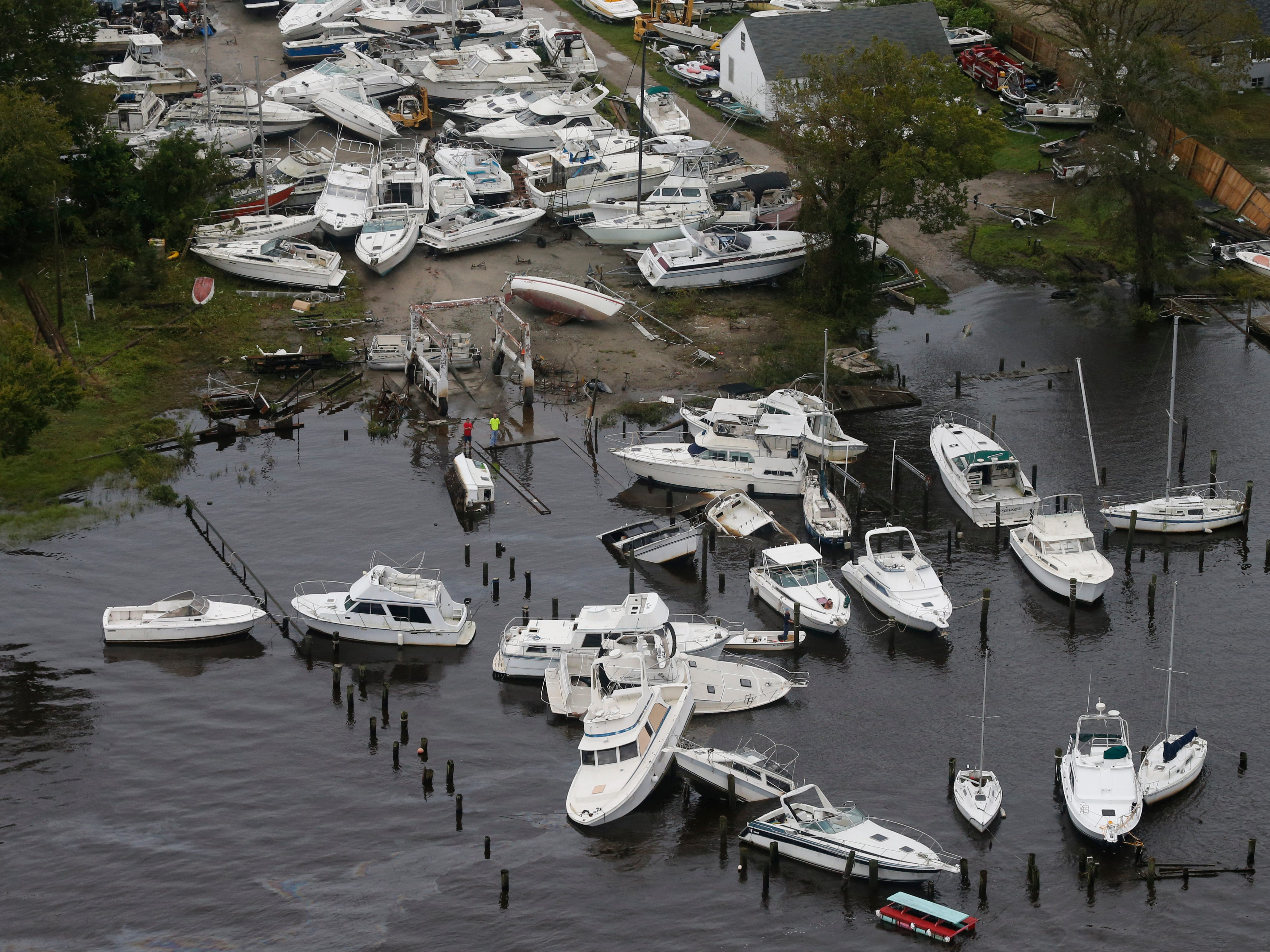 Boats are stacked up on each other in a marina as a result from Florence in New Bern, NC., Saturday, Sept. 15, 2018.