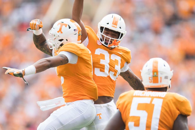 Tennessee running back Jeremy Banks (33) celebrates with Tennessee running back Tim Jordan (9) during a game between UT and UTEP in Neyland Stadium Sept. 15, 2018.