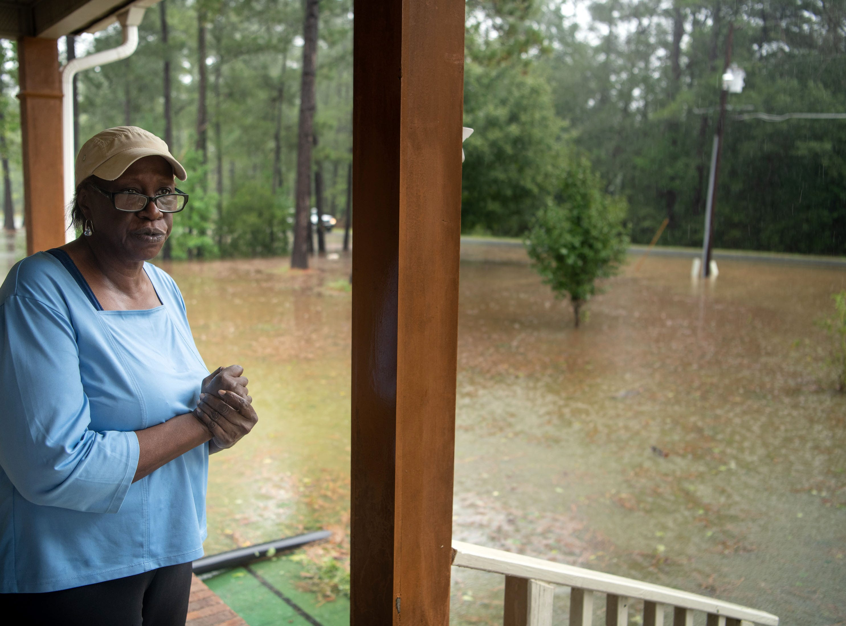 September 15, 2018; Lumberton, NC, USA;   Mittie Wooten watches her flooded front yard as rain from Tropical Storm Florence continues to fall on Lumberton, N.C., Saturday, Sept. 15, 2018.