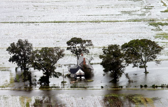 A farm house is surrounded by flooded fields from tropical storm Florence in Hyde County, N.C., Saturday, Sept. 15, 2018.