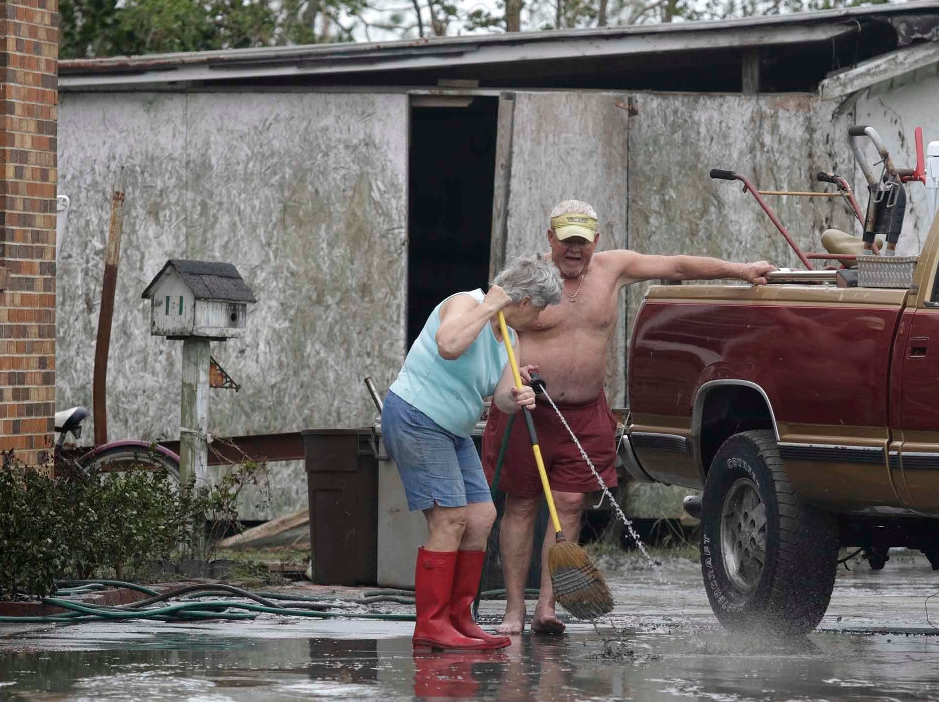 Lynda Willis and Gene Gillikin work to remove mud after Hurricane Florence hit Davis N.C.,Saturday, Sept. 15, 2018. It was said the storm surge was 4 1/2 feet in Davis, NC.