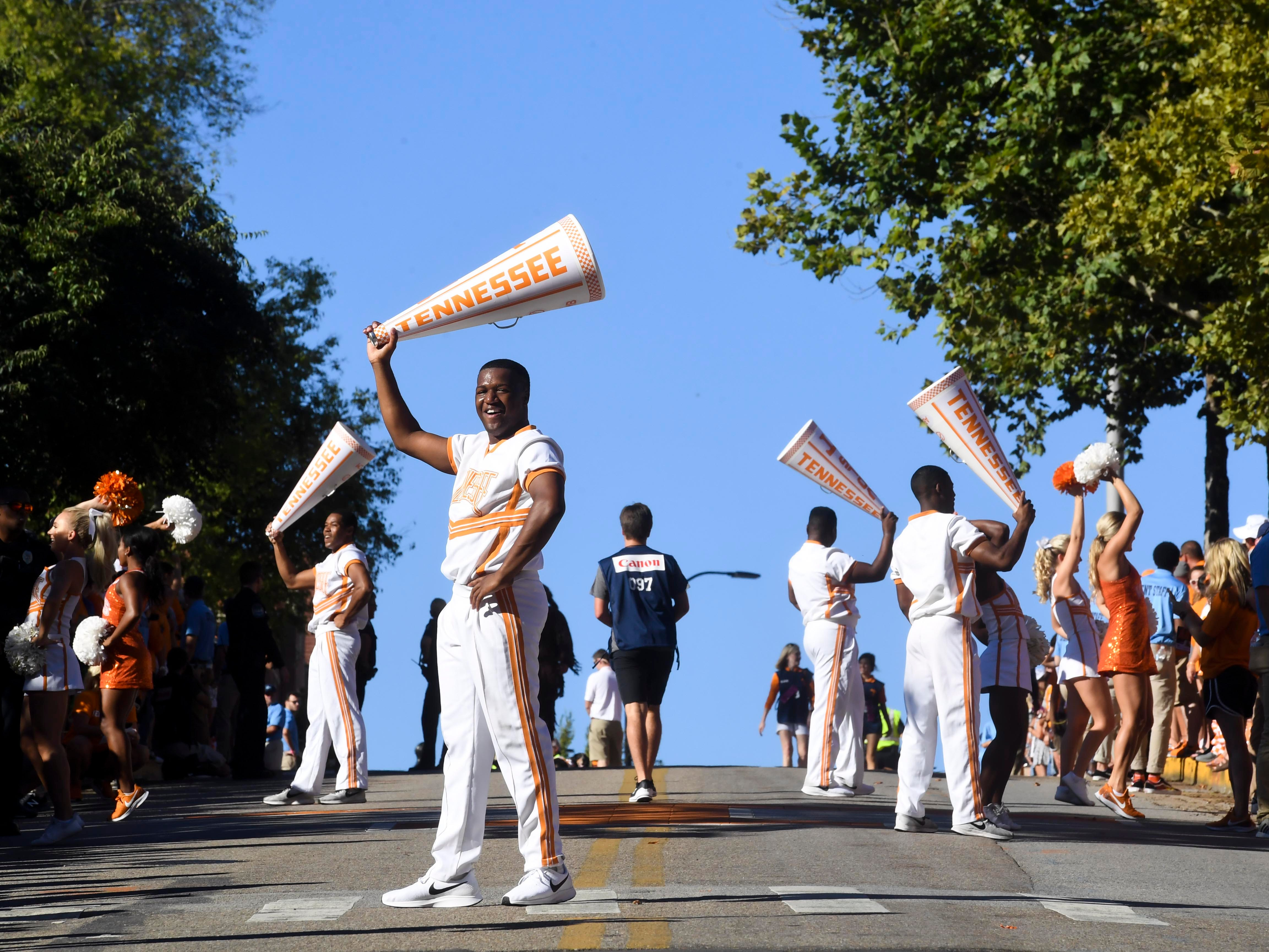 Tennessee cheerleaders encourage the crowds as they wait for the start of the Vol Walk on Saturday, September 15, 2018.